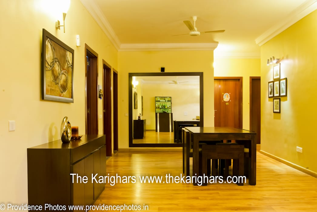 The Dining Area View :  Living room by The KariGhars