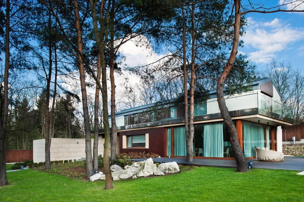 Maisons de style  par Zbigniew Tomaszczyk  Decorum Architekci Sp z o.o.,