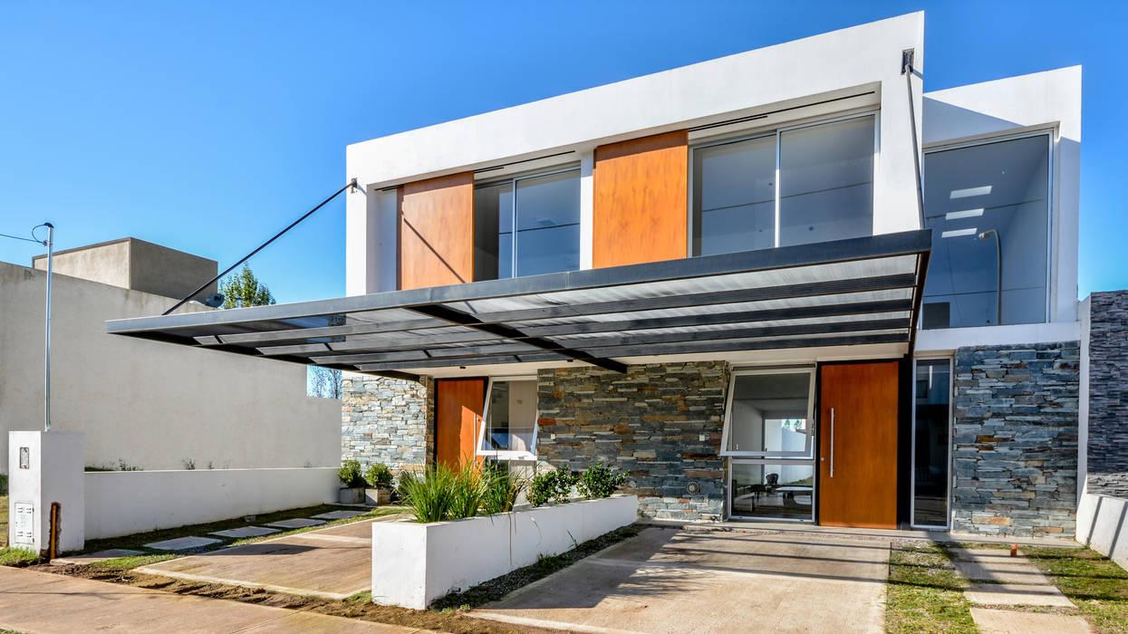 CASAS ADOSADAS: Casas de estilo  por Estudio A+3,