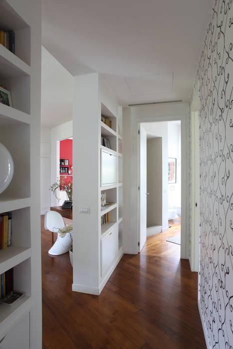 DISIMPEGNO: Case in stile  di Cristina Meschi Architetto