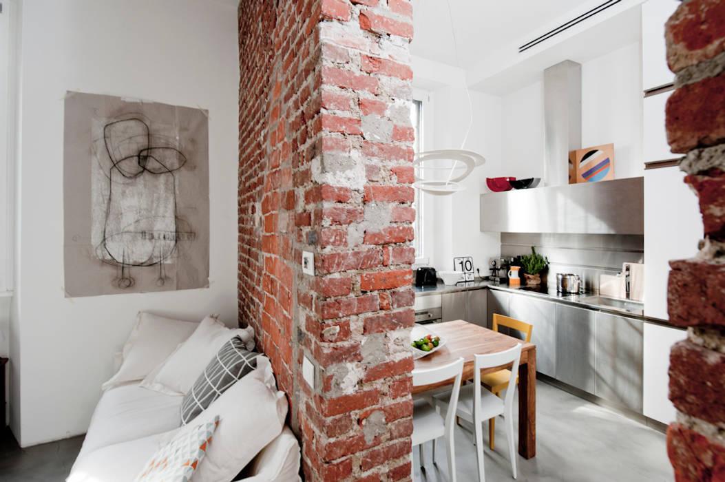 Casas de estilo  por Cristina Meschi Architetto, Industrial