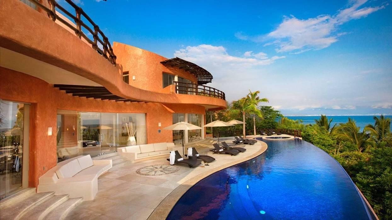 Houses by arqflores / architect, Tropical