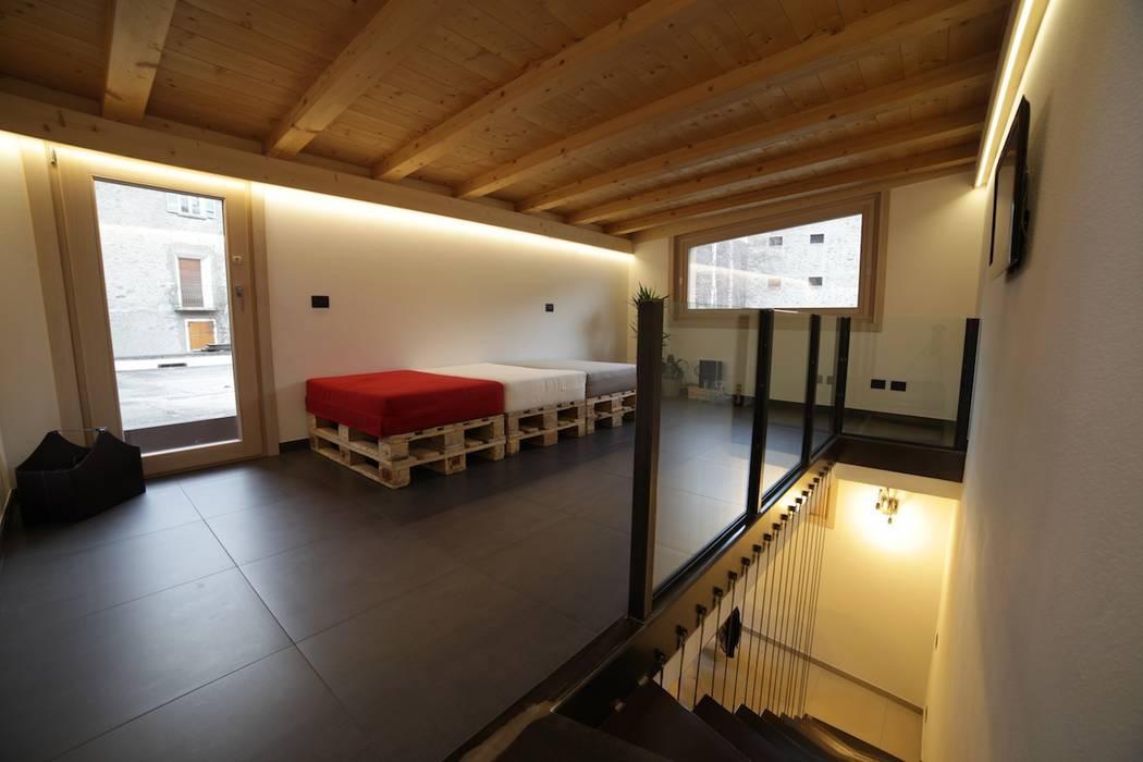JC's House: Case in stile  di BEARprogetti - Architetto Enrico Bellotti, Minimalista