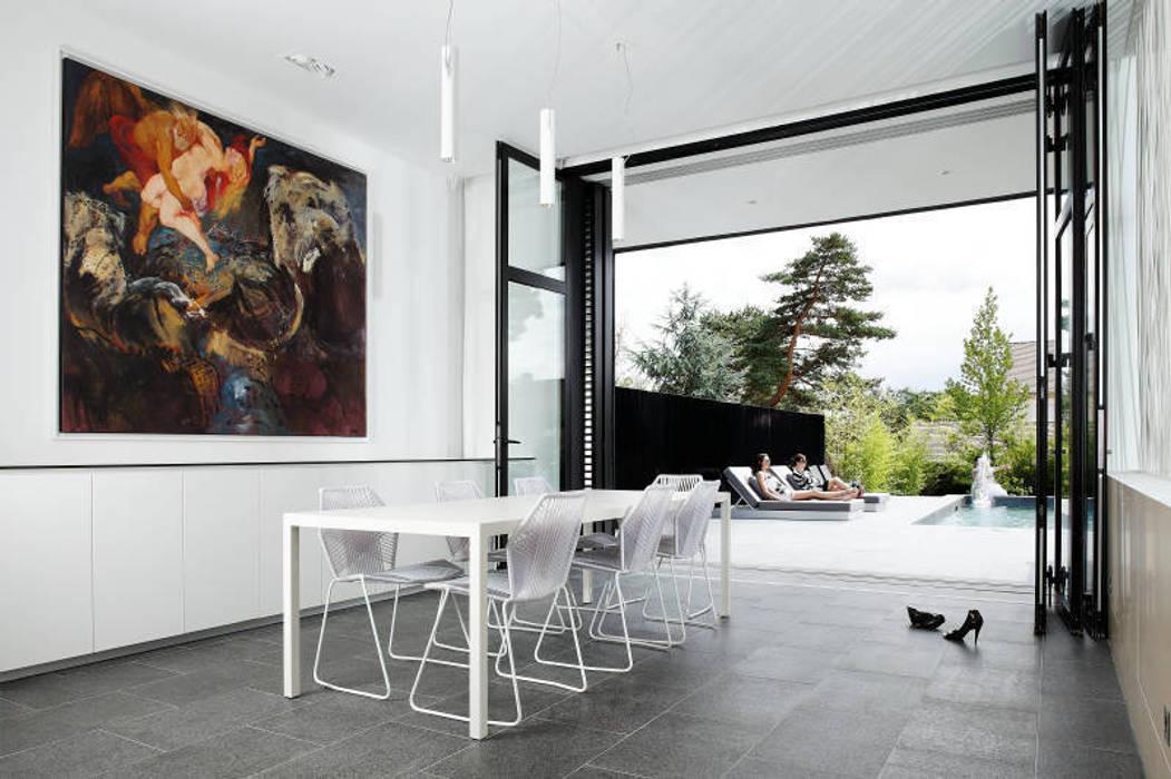 Maison C: Maisons de style  par Lode Architecture,