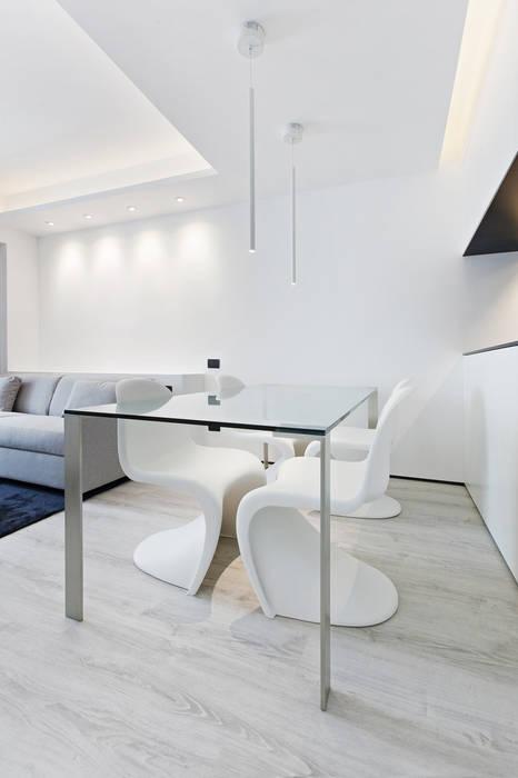 Comedores de estilo  por Arch. Andrea Pella, Moderno