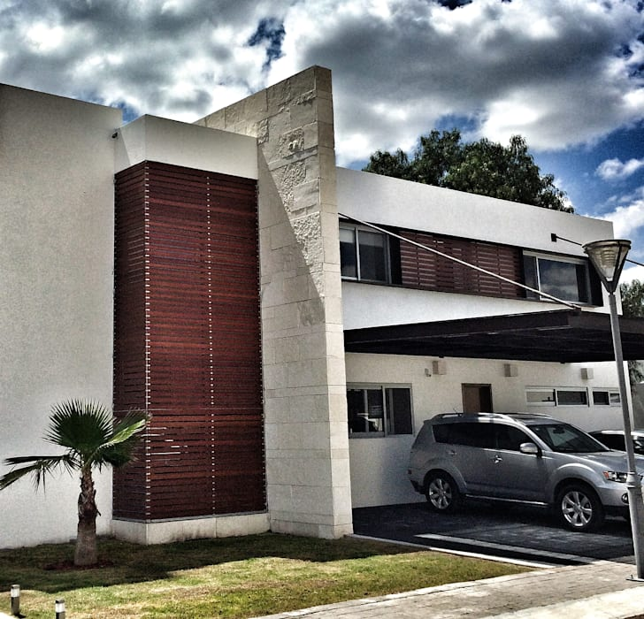 Casa Jurica: Casas de estilo  por REM Arquitectos,