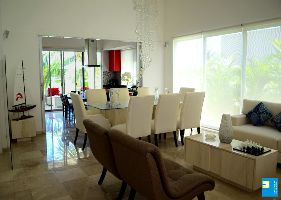 estancia: Comedores de estilo  por Excelencia en Diseño