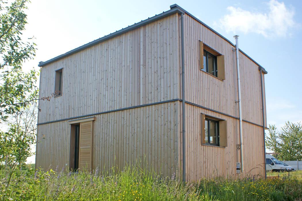 Vue du nord ouest Maisons modernes par ABA - Architecture Bioclimatique Auvergne Moderne
