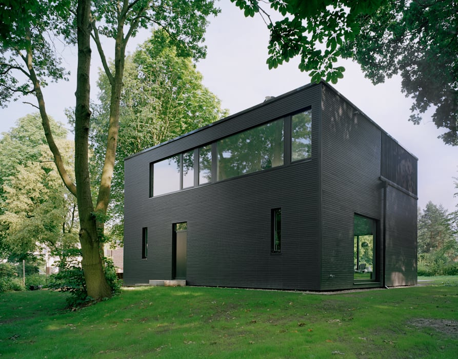 Casas de estilo minimalista de IOX Architekten GmbH Minimalista
