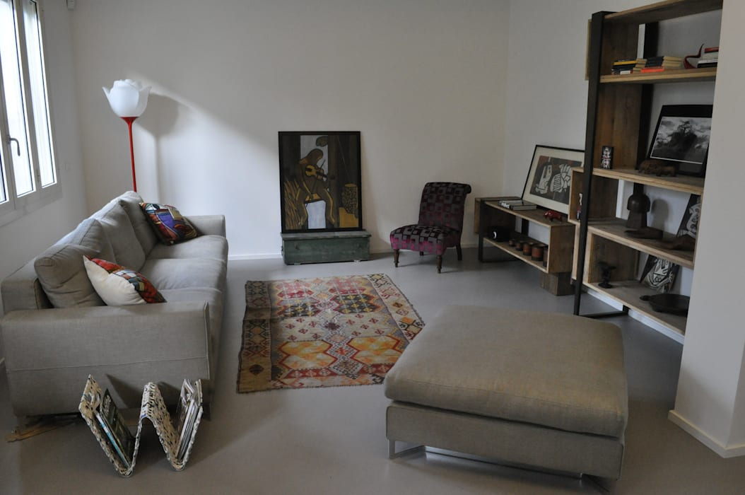 Casa M+C: L'arte dentro casa Case moderne di Architetto Francesco Franchini Moderno