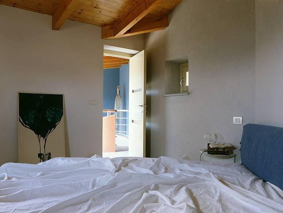 alessandromarchelli+designers AM+D studio Casas de estilo ecléctico