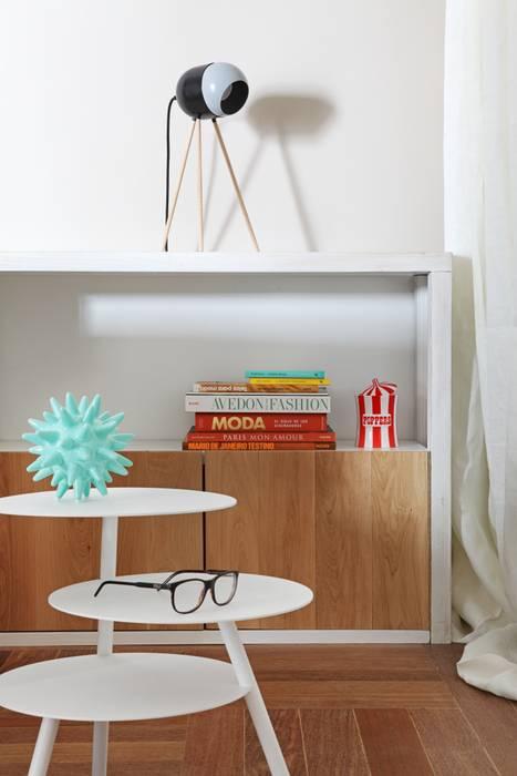 detalle de mobiliaio: Salones de estilo  de Sucursal urbana universo Sostenible