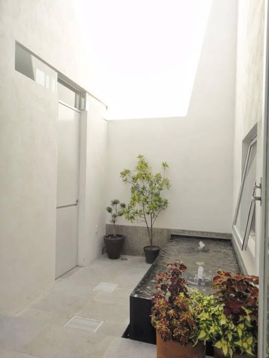 Casa Zaragoza: Jardines de estilo  por Abraham Cota Paredes Arquitecto