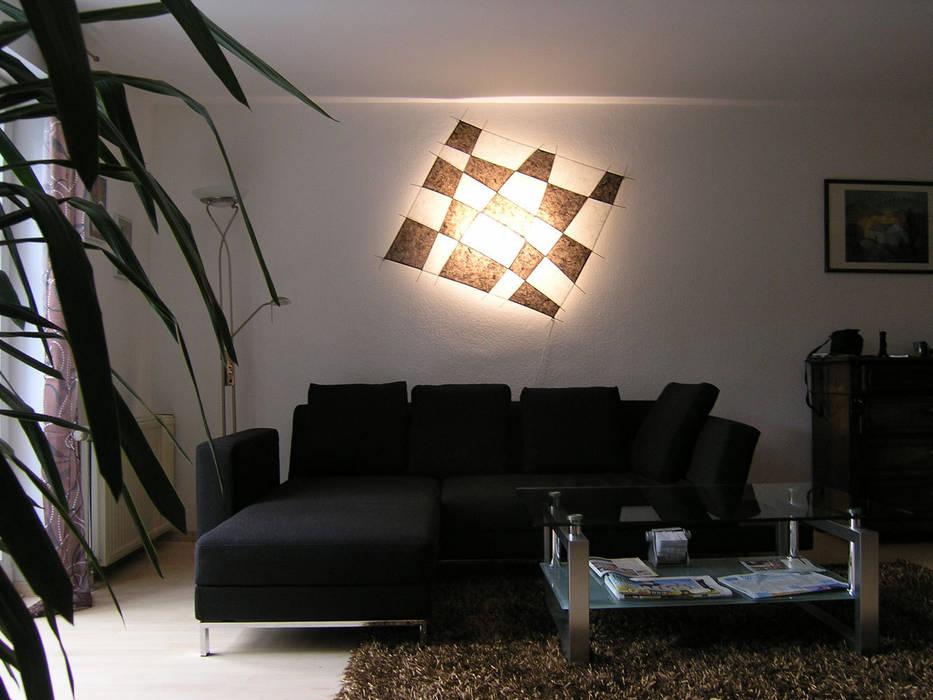 Drache schwarz-braun/weiß: moderne wohnzimmer von espo-leuchten | homify