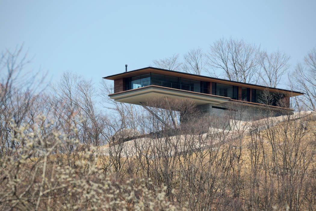 全景_見上げ: 城戸崎建築研究室 / KIDOSAKI ARCHITECTS STUDIOが手掛けた家です。