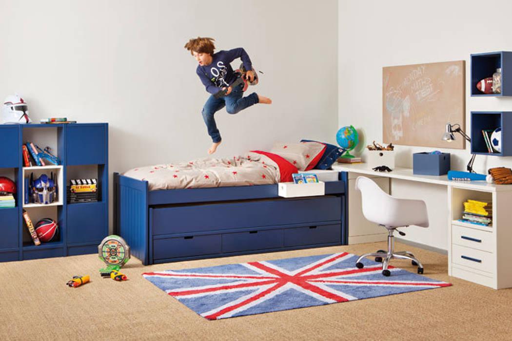 Dormitorio juvenil con zona de estudio de Sofás Camas Cruces Moderno