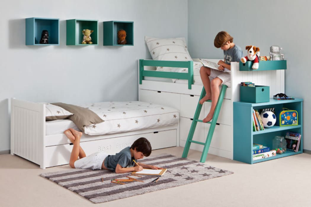 Habitación infantil con cama nido en ángulo Dormitorios infantiles de estilo moderno de Sofás Camas Cruces Moderno