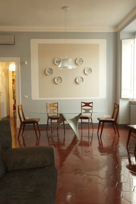 Soggiorno pranzo: Sala da pranzo in stile  di Quid divinum design