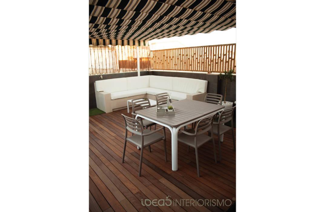 Terraza de diseño en Catarroja: Terrazas de estilo  de Ideas Interiorismo Exclusivo, SLU