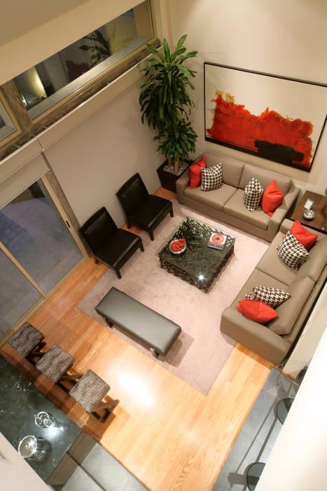 Casa Caritas No.58 Salones modernos de ARQUIPLAN Moderno