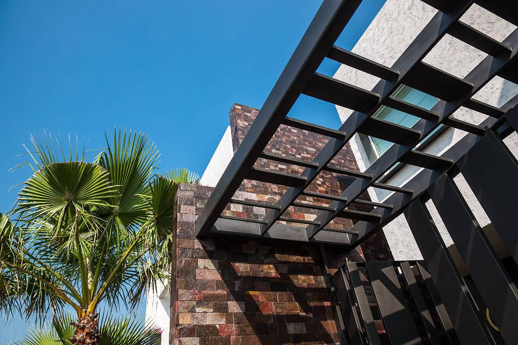 Detalle Fachada Jardines modernos de ARQUIPLAN Moderno