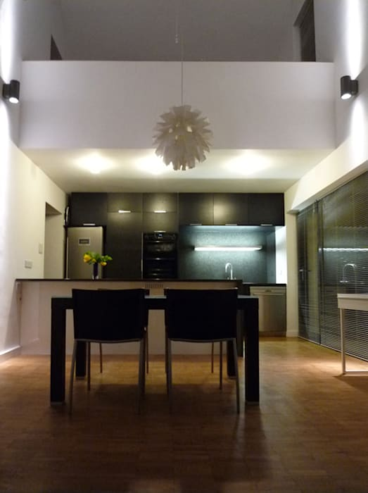 Double Height Open-Plan Kitchen and Dining Room Modern dining room by ArchitectureLIVE Modern