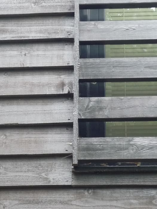 Thermally Insulated Black Timber Cladding detail: modern Houses by ArchitectureLIVE