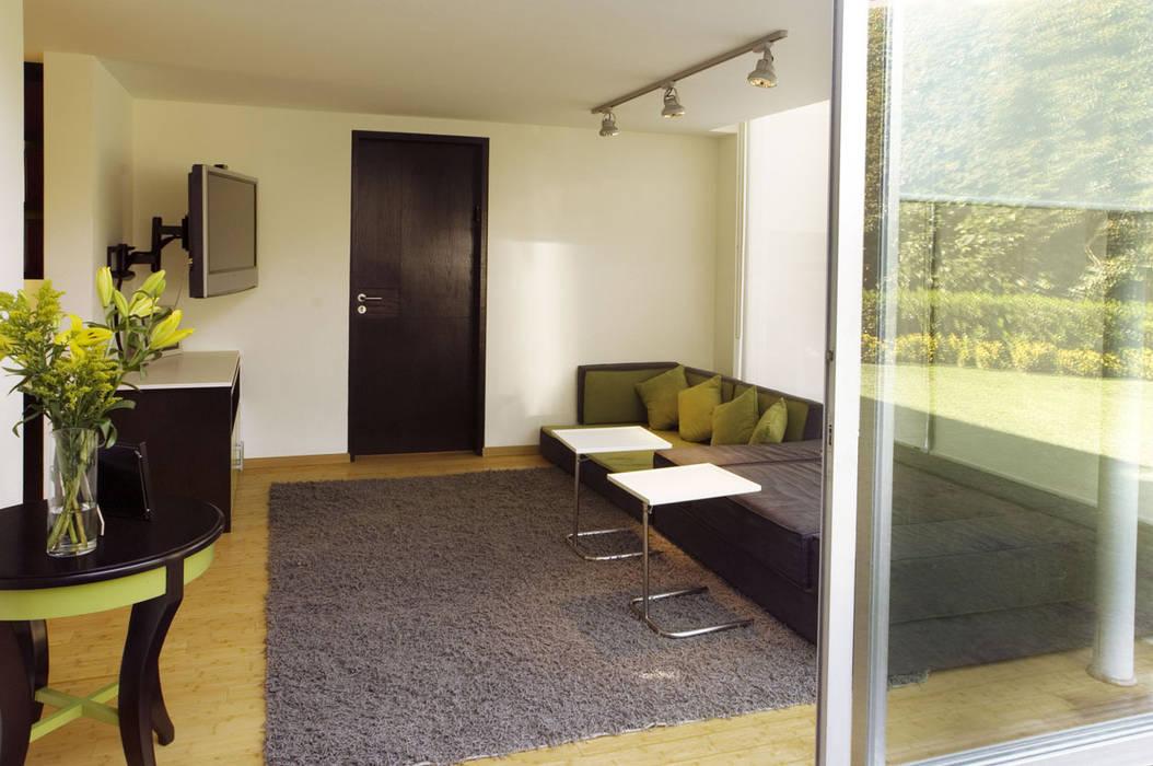 Casa Sauces: Salas de estilo  por ARCO Arquitectura Contemporánea ,