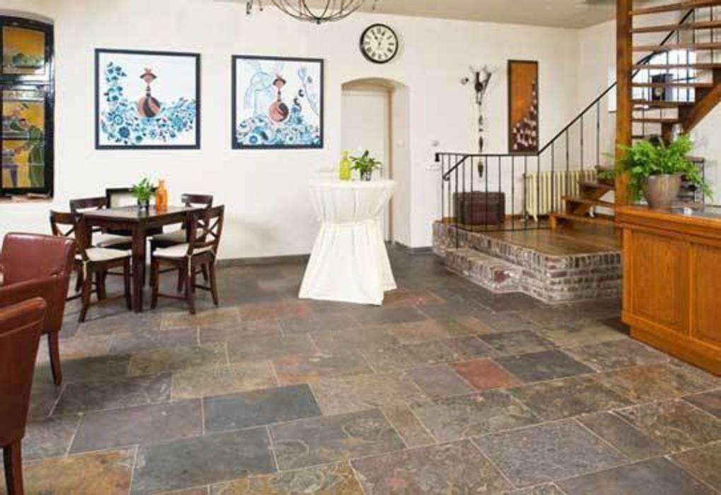 La pierre naturelle chez vous: Murs de style  par Design Pierres Naturelles, Rustique