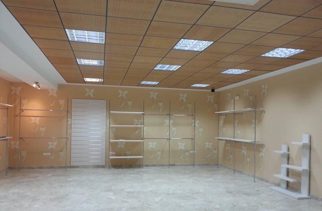 Espacio Comercial.: Oficinas y Tiendas de estilo  de rh interiorismo