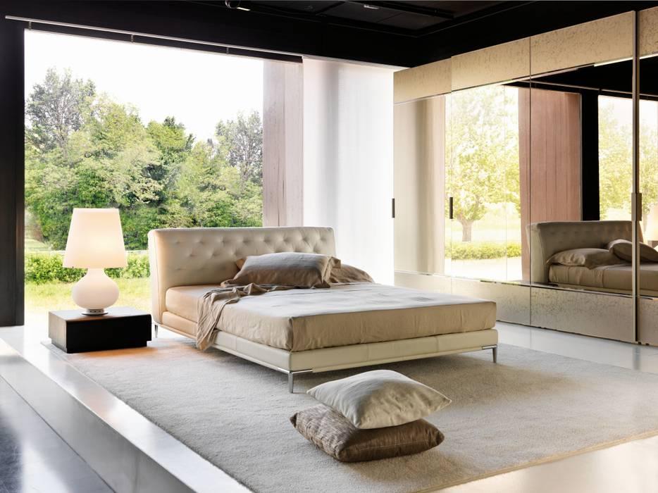 Letto Marlene: Camera da letto in stile  di la falegnami,