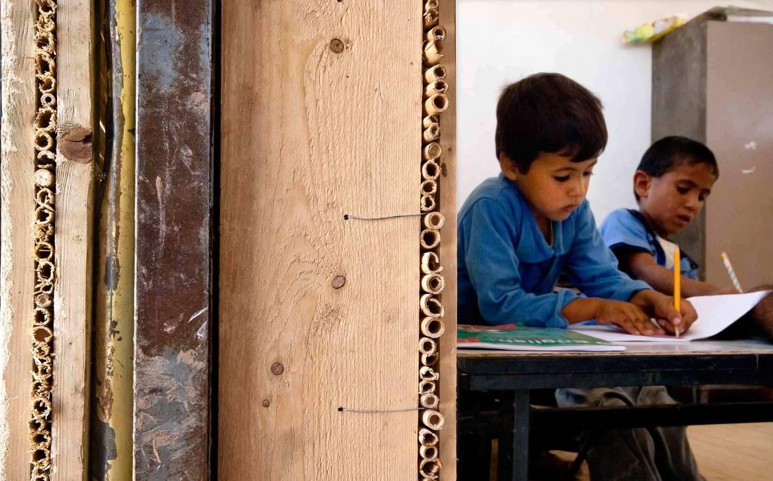 ARCò Architettura & Cooperazione Eclectic style schools