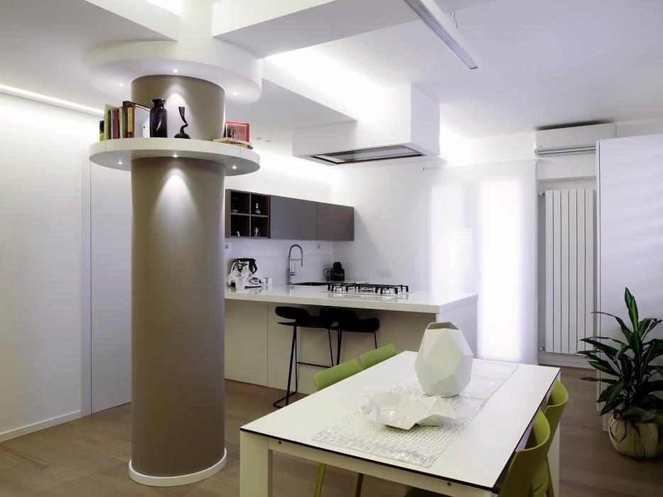 Dining room by Laboratorio di Progettazione Claudio Criscione Design , Modern