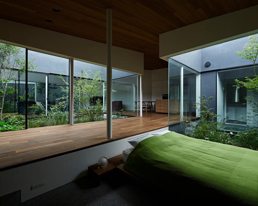 House in Higashimurayama Pasillos, vestíbulos y escaleras de estilo moderno de 石井秀樹建築設計事務所 Moderno