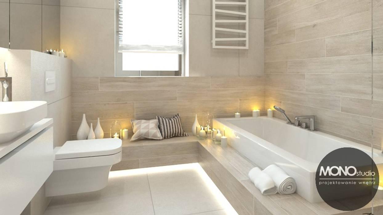 Jasne przestronne wnętrza domu w Waganowicach dają poczucie spokoju i sprzyjają relaksowi Nowoczesna łazienka od MONOstudio Nowoczesny