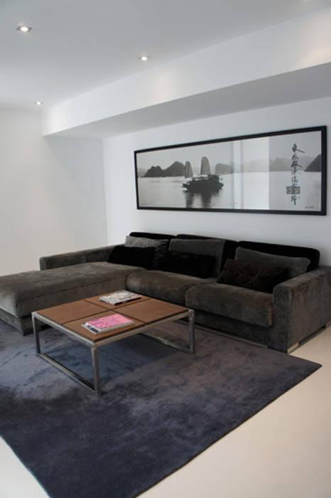 Apartamento Ibiza Salones de estilo moderno de Isa de Luca Moderno
