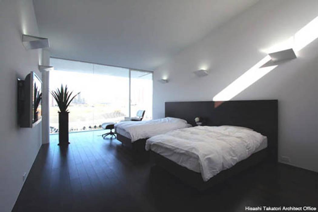 Dormitorios de estilo minimalista de 鷹取久アーキテクトオフィス Minimalista