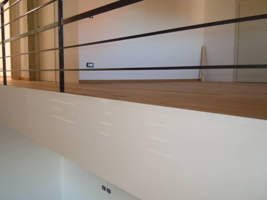 Parquet incassato: Case in stile in stile Moderno di ENRICO MARCHIARO _ eMsign Studio _ Architettura_Interior Design