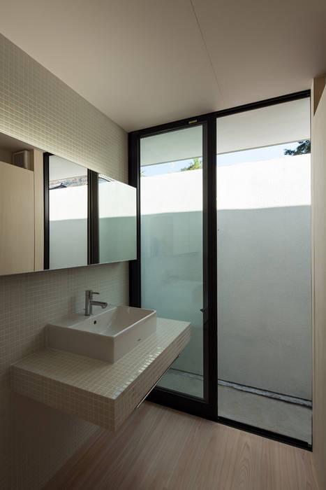 洗面脱衣室: 川添純一郎建築設計事務所が手掛けた家です。