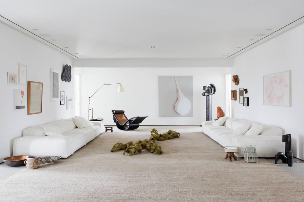 Apartamento da Colecionadora Salas de estar minimalistas por homify Minimalista
