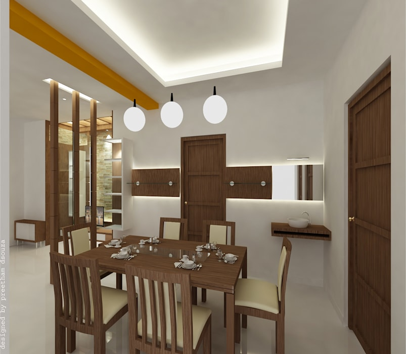 Dining spaces:  Dining room by Preetham  Interior Designer