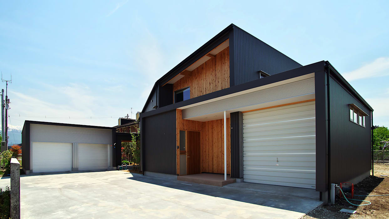 Eclectic style houses by 水野建築研究所 Eclectic