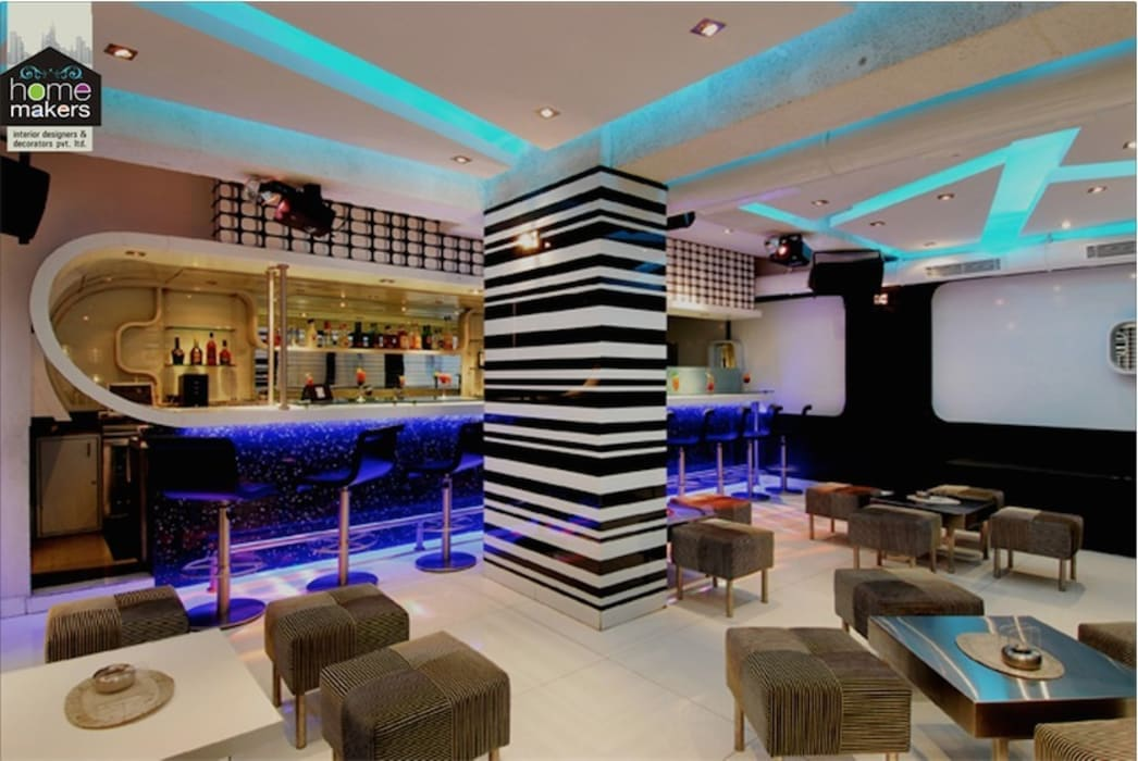 Restaurant with Bar: modern Dining room by home makers interior designers & decorators pvt. ltd.