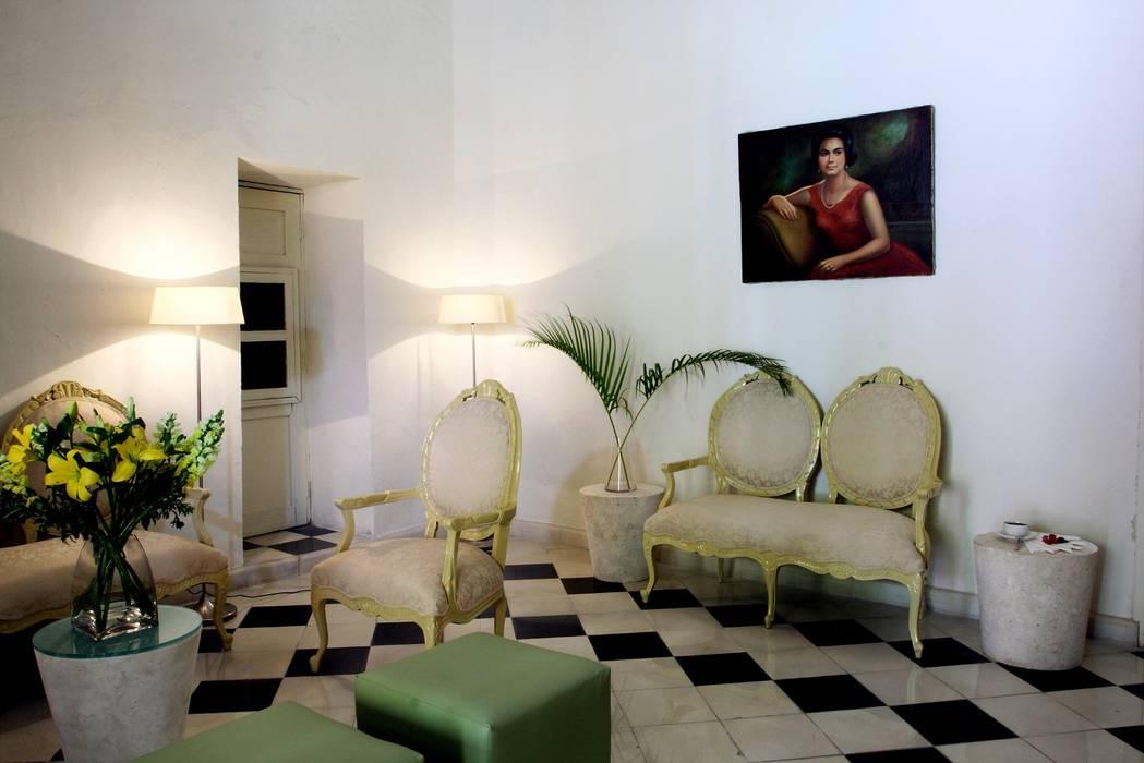 Cafetería: Hoteles de estilo  por Taller Estilo Arquitectura,