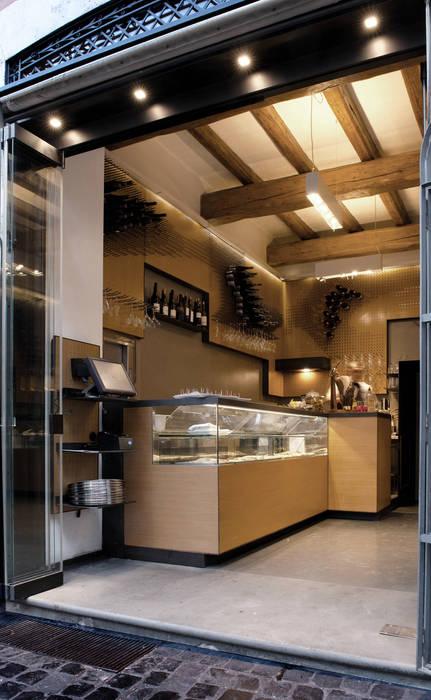 Bar Teichner ingresso B: Negozi & Locali commerciali in stile  di Anomia Studio