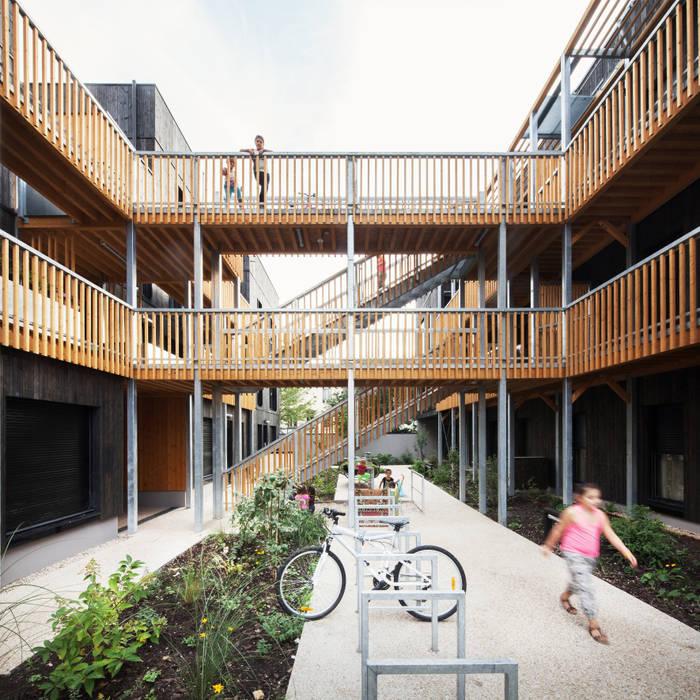 LA ARCHITECTURES 18 Logements rue Dolet: Maisons de style de style Moderne par LA Architectures