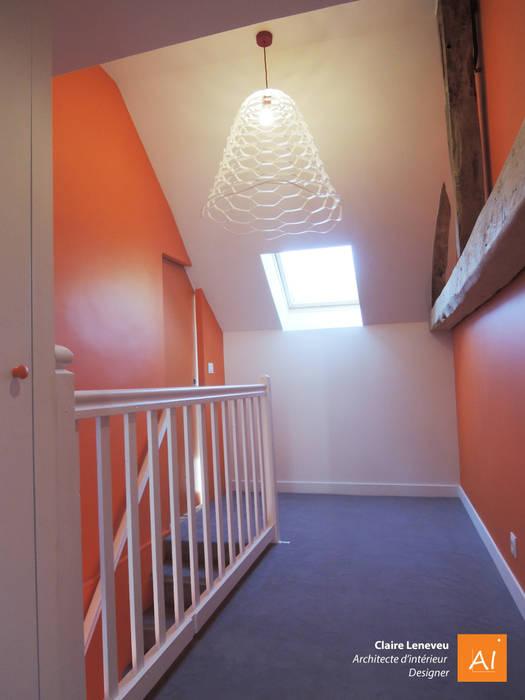 Palier de l'étage dédié aux petits-enfants: Couloir et hall d'entrée de style  par Claire Leneveu