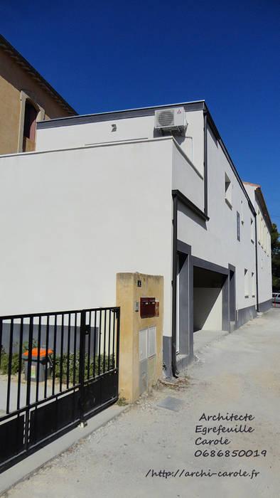 Un petit collectif à Saint Georges d'Orques: Maisons de style de style Moderne par Architecte Egrefeuille Carole