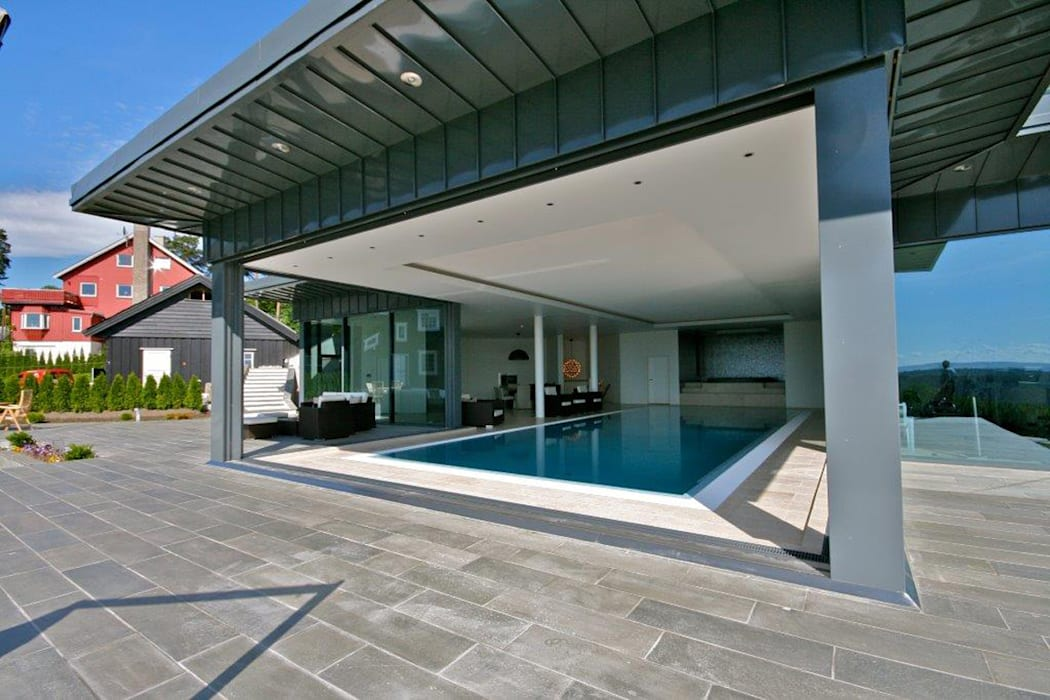 Pool House at a Private Villa in Oslo, Norway: modern Houses by Descender Fronts by Kollegger