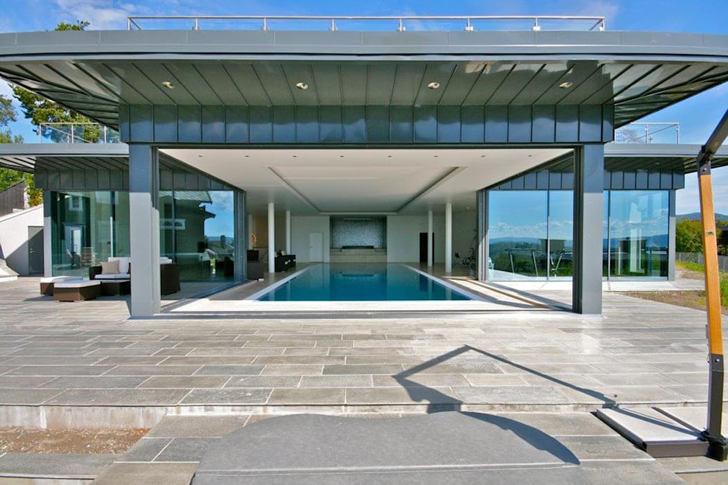 Pool House at a Private Villa in Oslo, Norway:  Houses by Descender Fronts by Kollegger